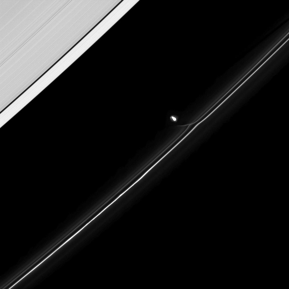 Fresh from an encounter with Saturn's F ring, the moon Prometheus continues in its orbit.