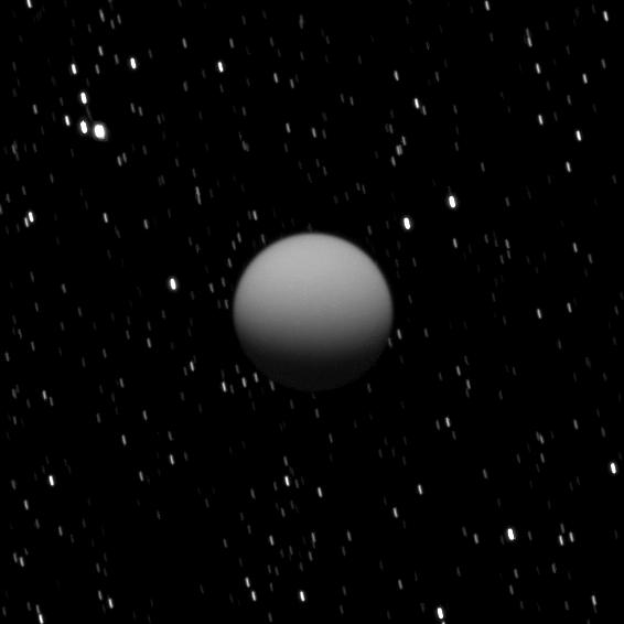 The Cassini spacecraft captured this image of a dimly lit Titan as Saturn's largest moon was eclipsed by the planet.