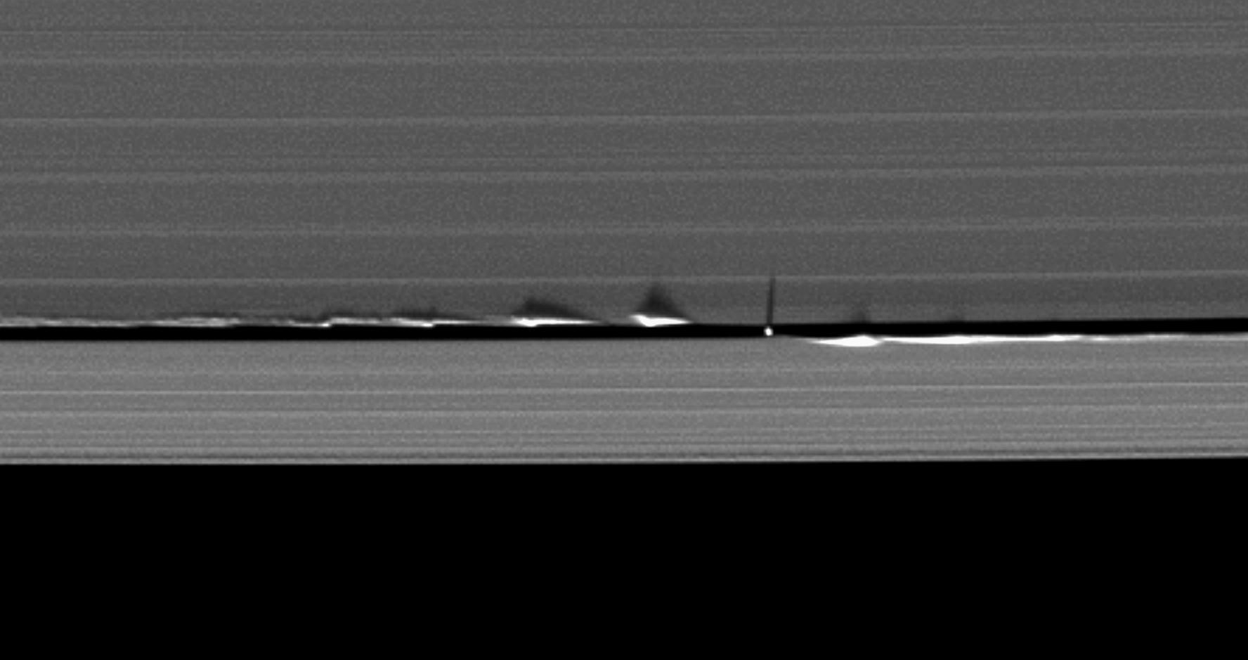 Never-before-seen looming vertical structures created by the tiny moon Daphnis