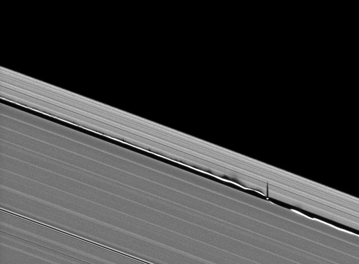 Vertical structures created by Saturn's small moon Daphnis cast long shadows across the rings in this dramatic image taken as the planet approaches its mid-August 2009 equinox