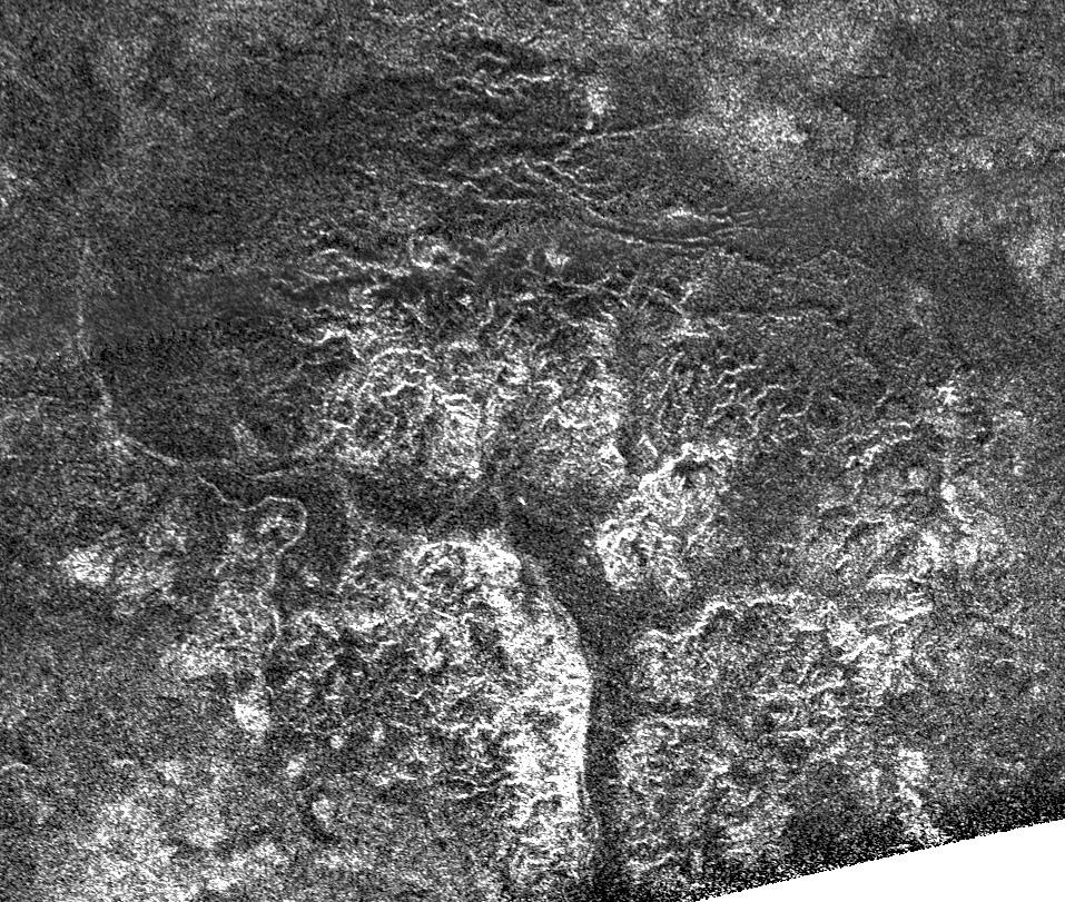 Complex and unique canyon systems appear to have been intricately carved into older terrain by the ample flow of liquid methane rivers on Saturn's moon Titan, as seen in this radar image