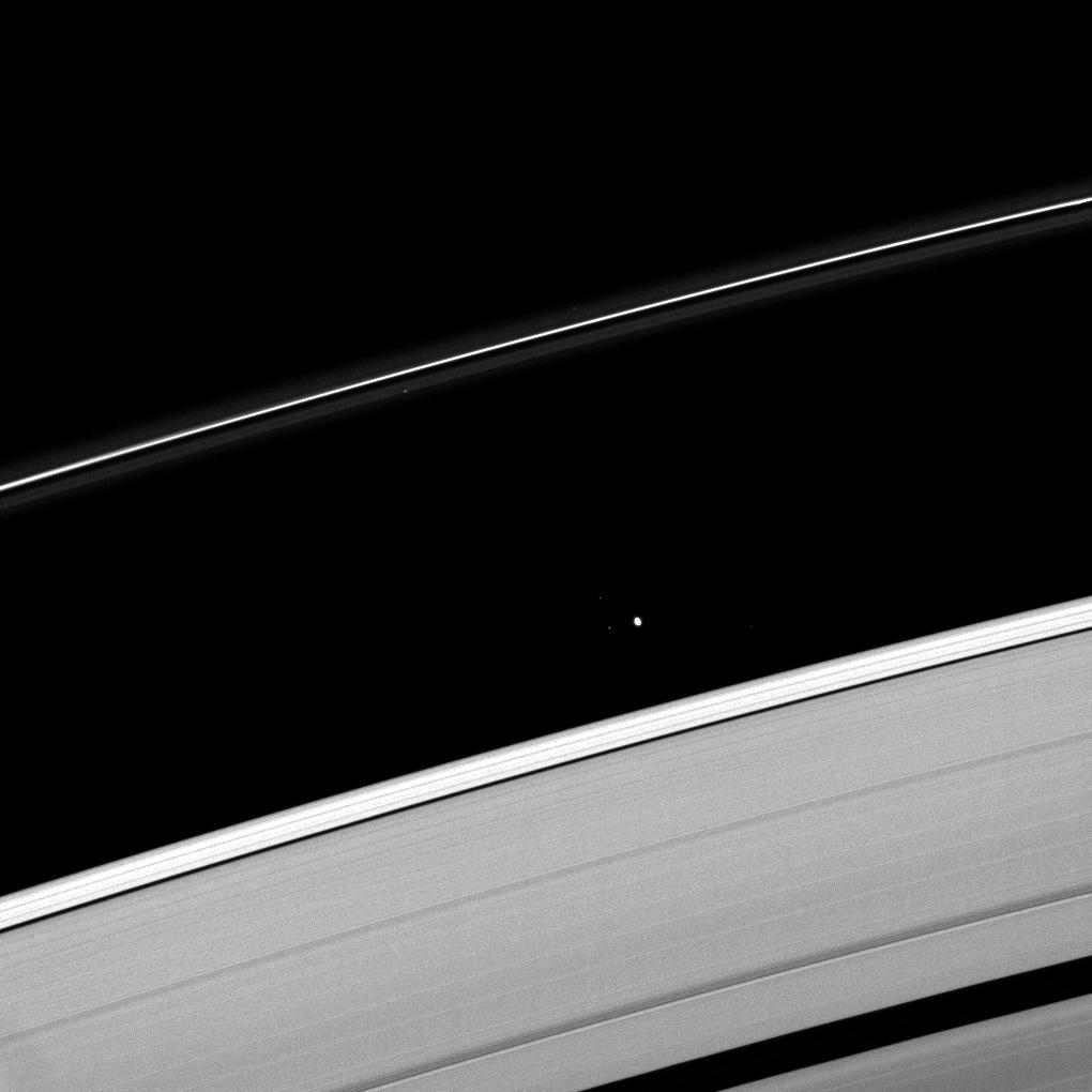 Saturn's moon Atlas plies the Roche Division between the A ring and the thin F ring.