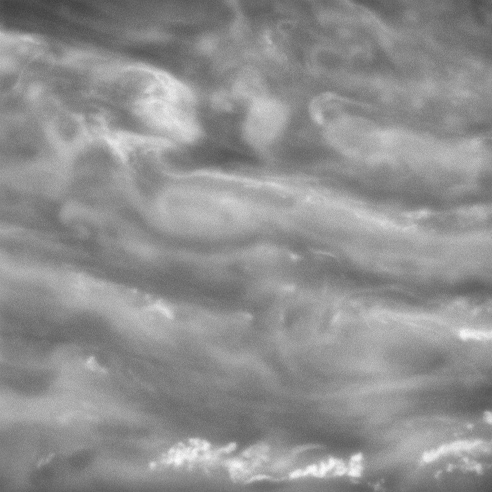 Swirling clouds in Saturn's murky depths