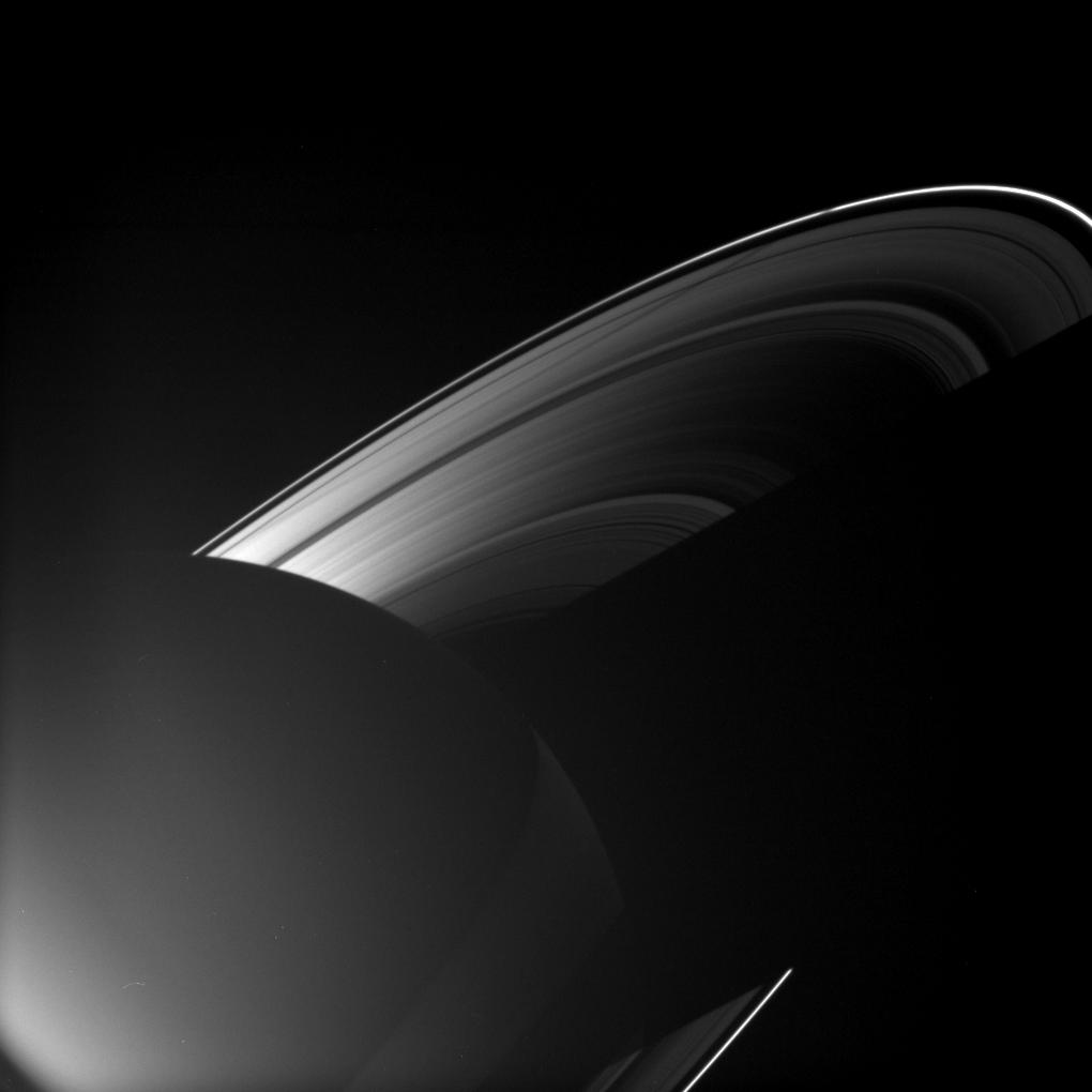 Rhea casting a shadow on Saturn's rings