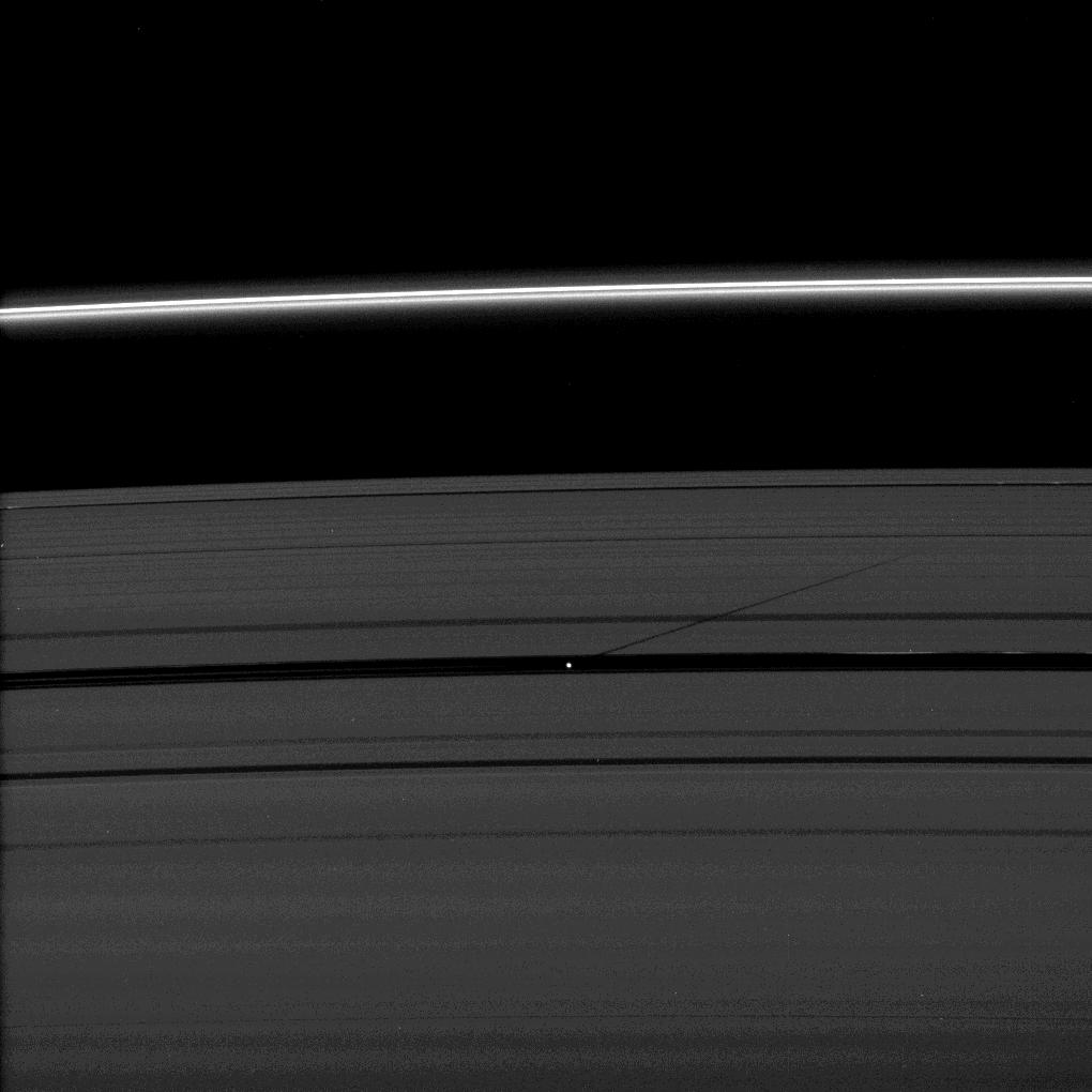 The moon Pan casts a shadow on Saturn's outer A ring in this image taken as the planet approached its August 2009 equinox.