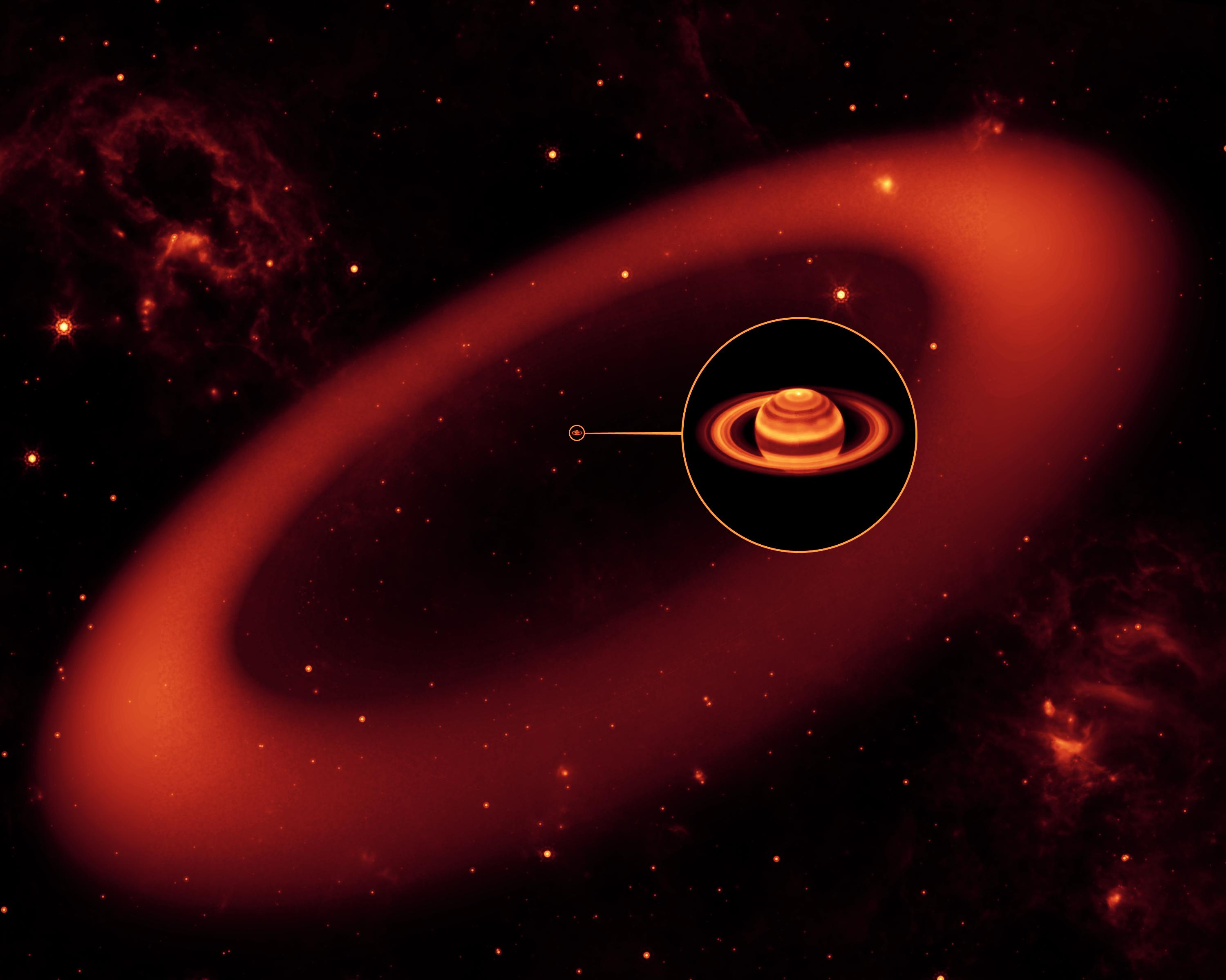 This artist's conception shows a nearly invisible ring around Saturn -- the largest of the giant planet's many rings.