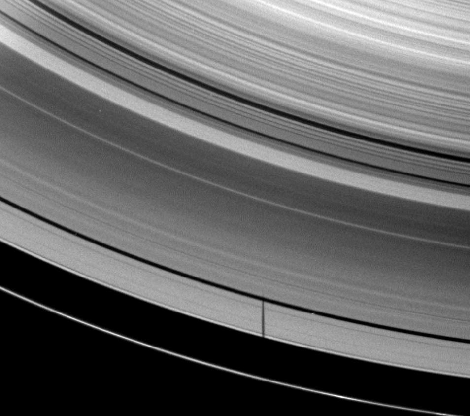 The moon Janus casts a shadow on Saturn's A ring but misses the thin F ring