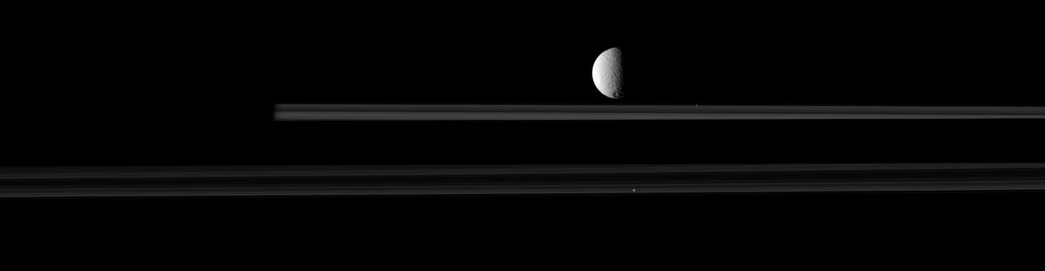 The moon Tethys is upstaged by two smaller moons in this movie from Cassini.