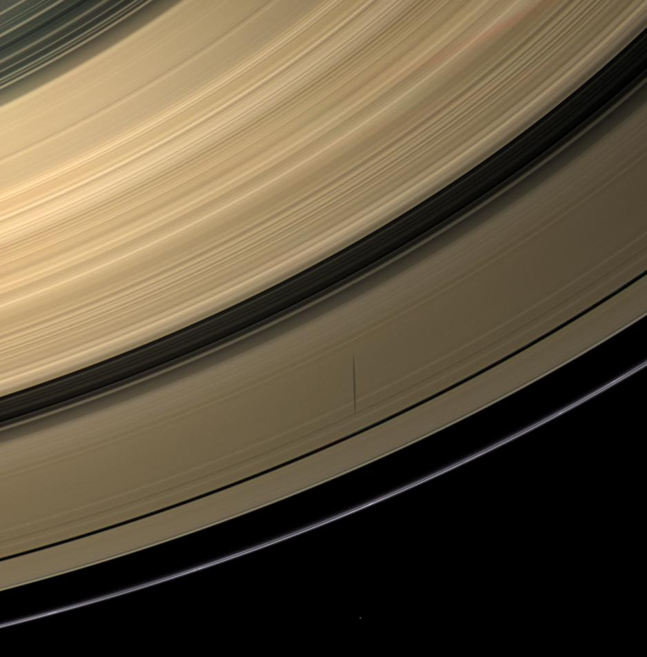 Epimetheus casts a shadow across colorful Saturn's rings