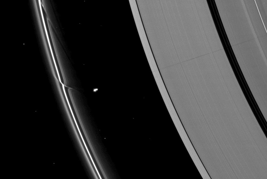 The effects of the small moon Prometheus loom large on two of Saturn's rings