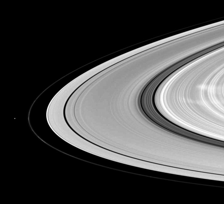Saturn's moon Pandora shares the stage with ghostly B ring spokes in this Cassini spacecraft scene.