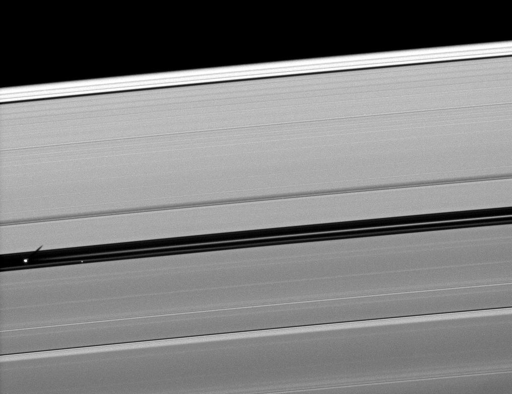 Orbiting in the Encke Gap of Saturn's A ring, the moon Pan casts a shadow on the ring in this image taken about six months after the planet's August 2009 equinox.