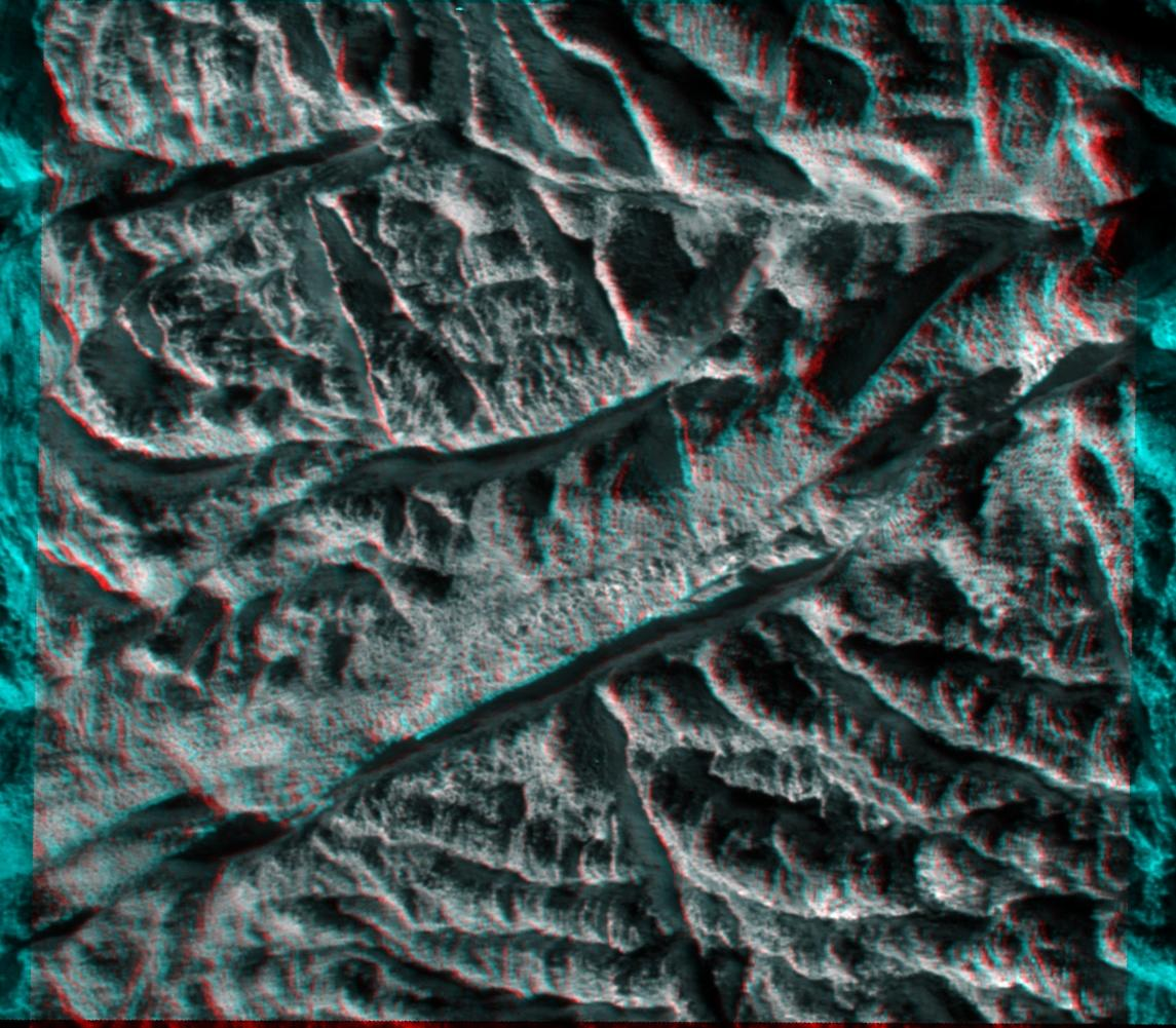 "This anaglyph made from images captured by NASA's Cassini spacecraft shows a dramatic, 3-D view of one of the deep fractures nicknamed ""tiger stripes"" on Saturn's moon Enceladus."