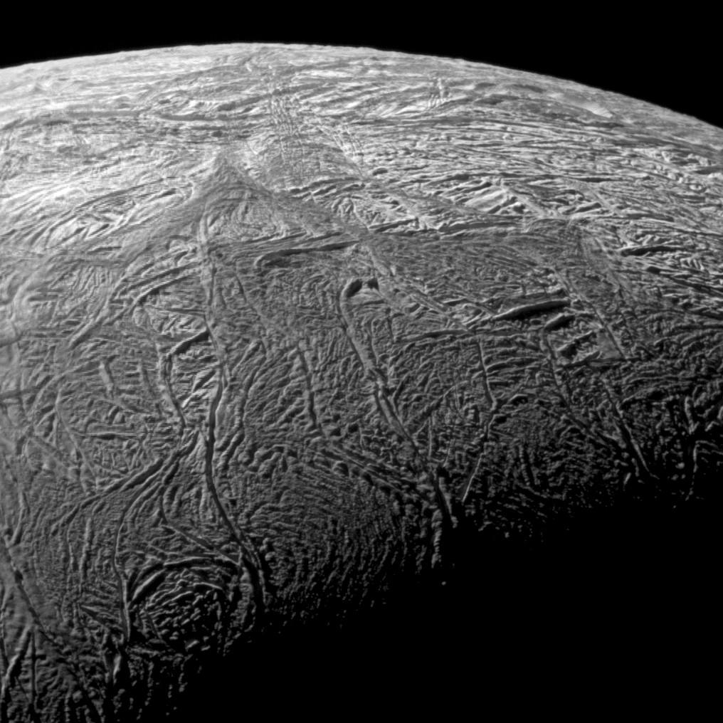 This wide-angle image shows the south polar region of Saturn's moon Enceladus and outlines the area covered by the high-resolution mosaic combining data from the imaging science subsystem and composite infrared spectrometer aboard NASA's Cassini spacecraft