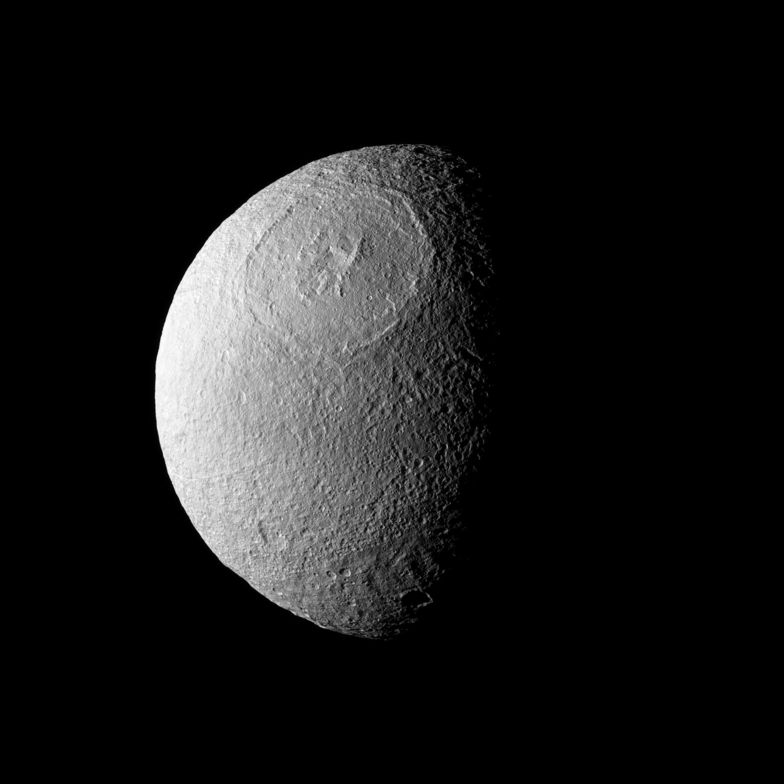Odysseus Crater stretches across a large northern expanse on Tethys.