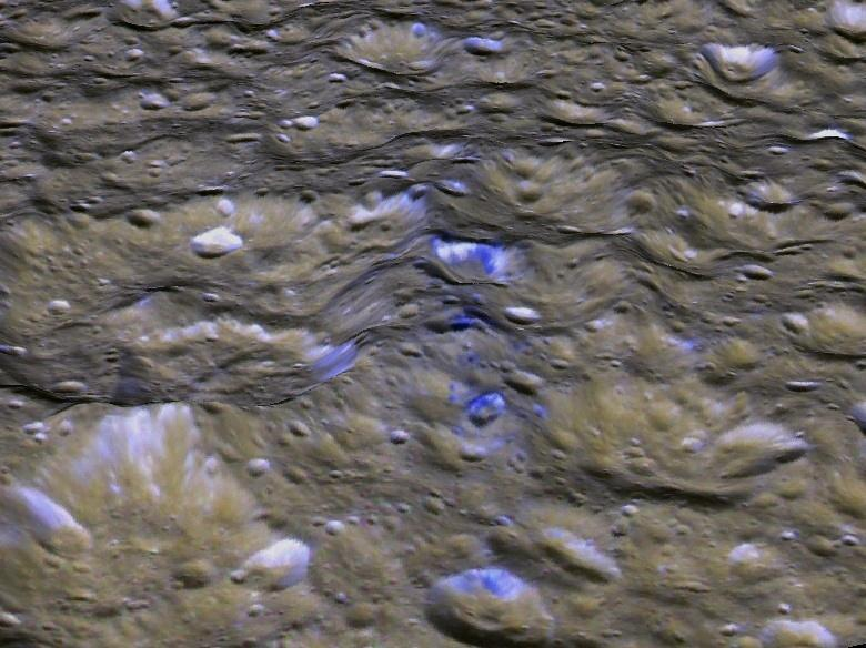 This perspective view shows one of a series of relatively blue patches that form a very narrow band only 10 kilometers wide that straddles Rhea's equator.