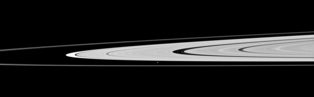 Saturn's moon Atlas, just below the center of this image, orbits in the Roche Division between the A ring and thin F ring.