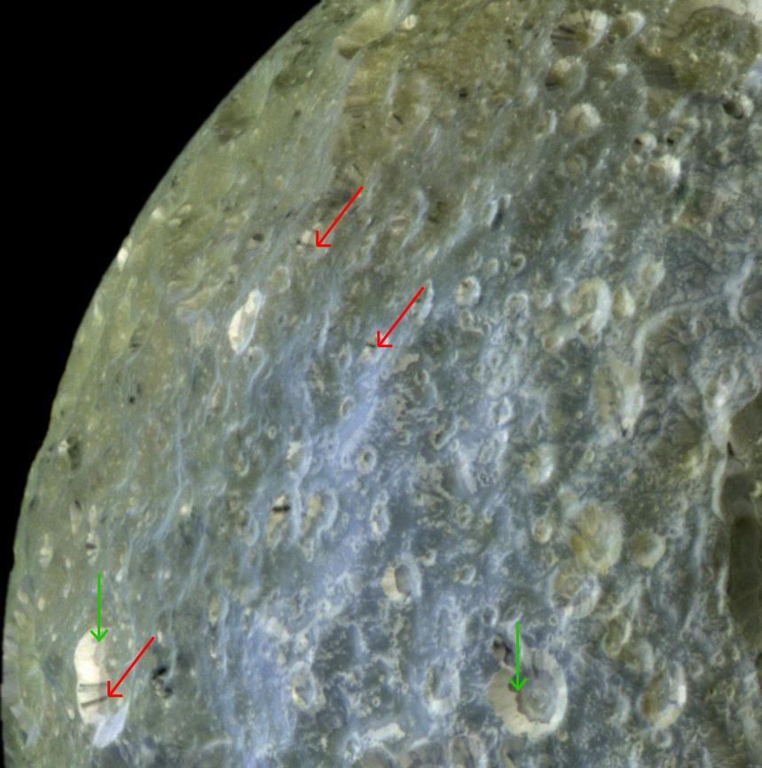 This false-color view of Mimas accentuates terrain-dependent color differences and shows dark streaks running down the sides of some of the craters