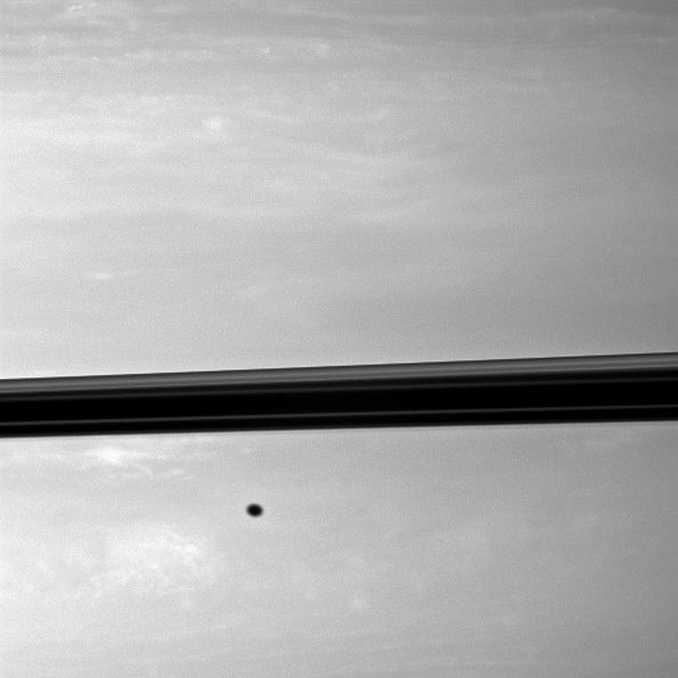 a shadow from the moon Enceladus on Saturn