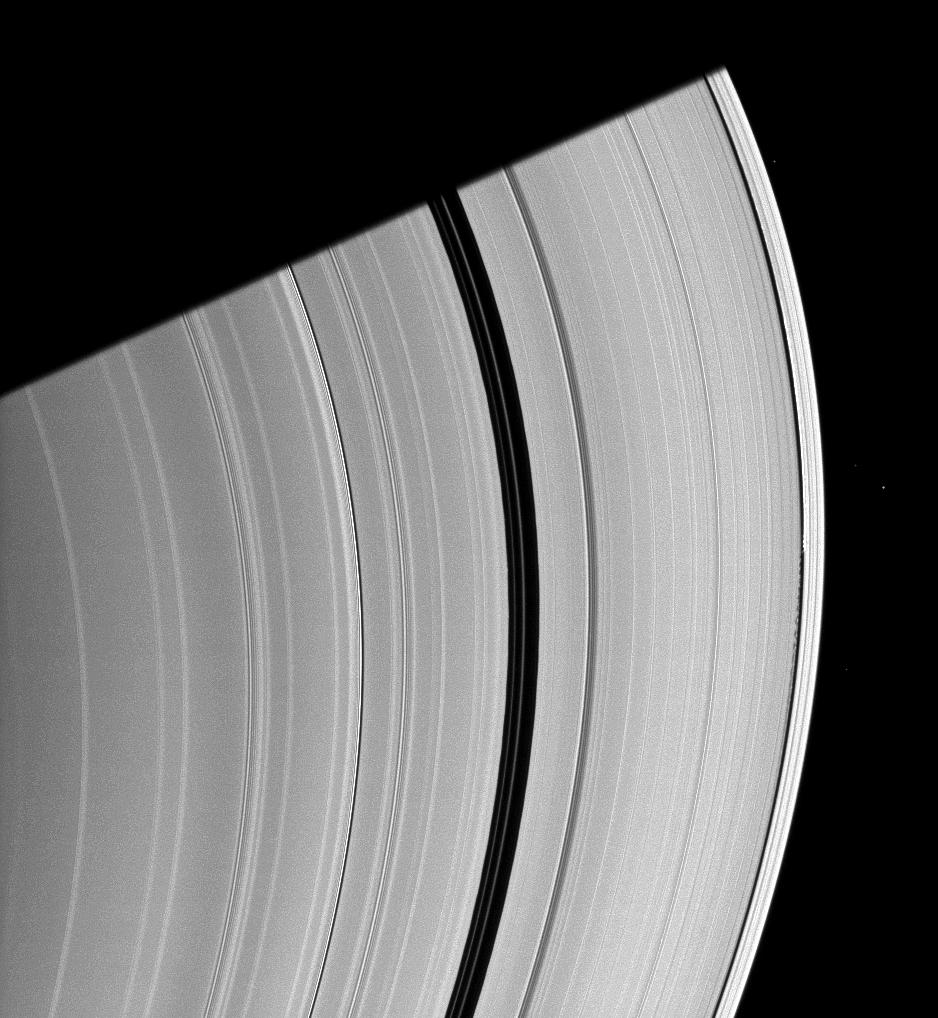 Saturn's moon Daphnis appears as a tiny speck in the Keeler Gap of the A ring