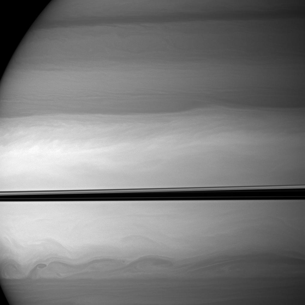 The Cassini spacecraft watches as clouds swirl through Saturn's equatorial latitudes.