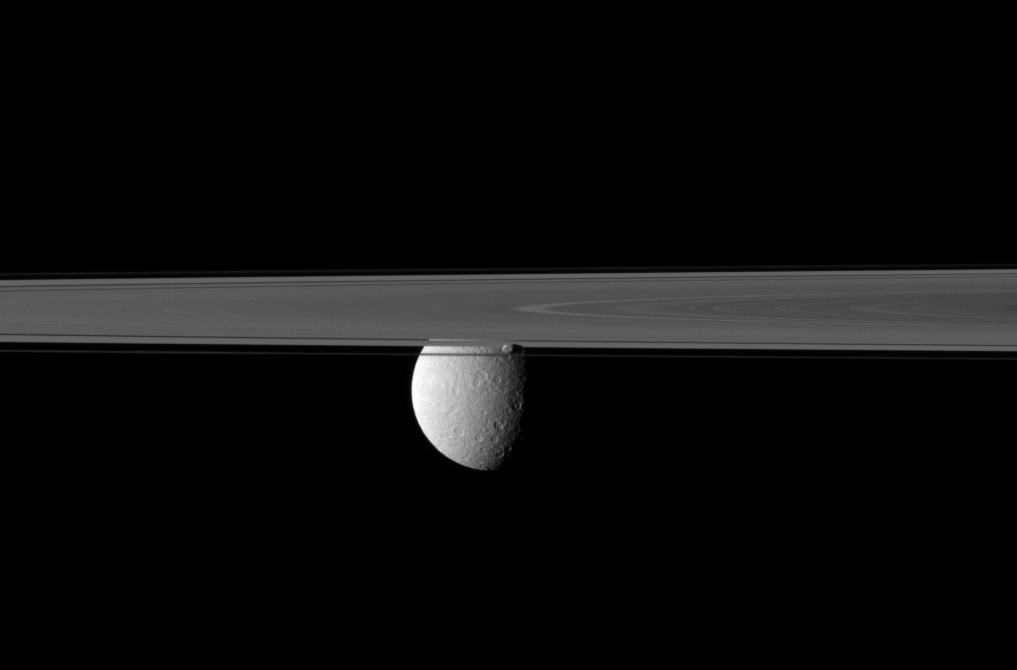 Saturn's rings and Prometheus obscure Cassini's view of Rhea