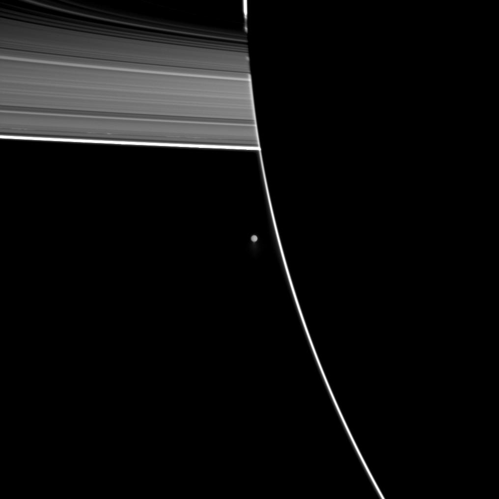 Enceladus beyond the outline of the Saturn's night side