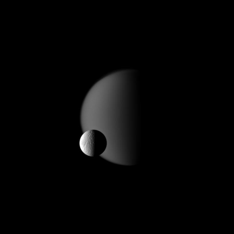 Tethys in front of Titan