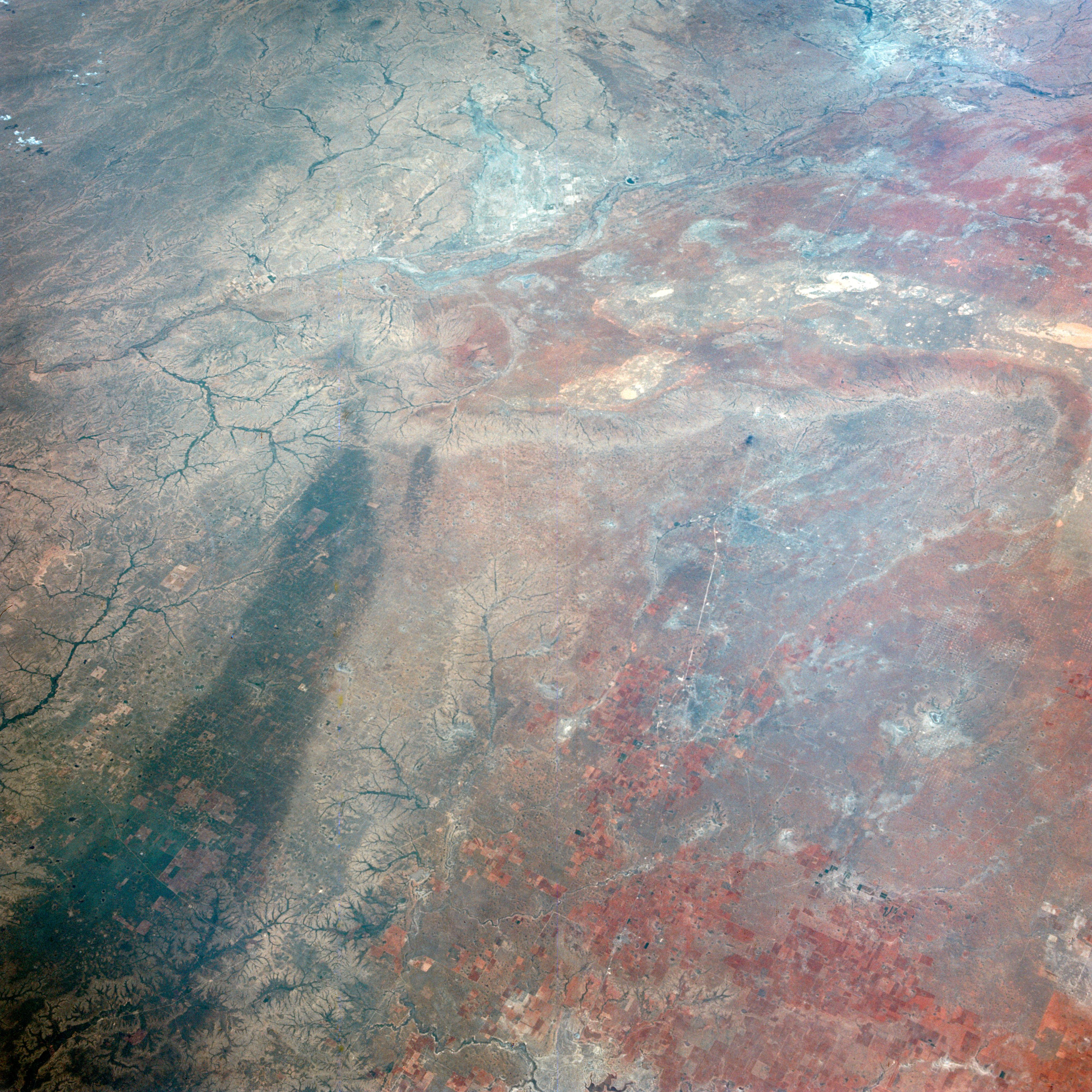 This image of Texas, obtained by astronauts aboard NASA's Gemini 4 spacecraft on June 5, 1965, shows a large dark swath attributed to rainfall.