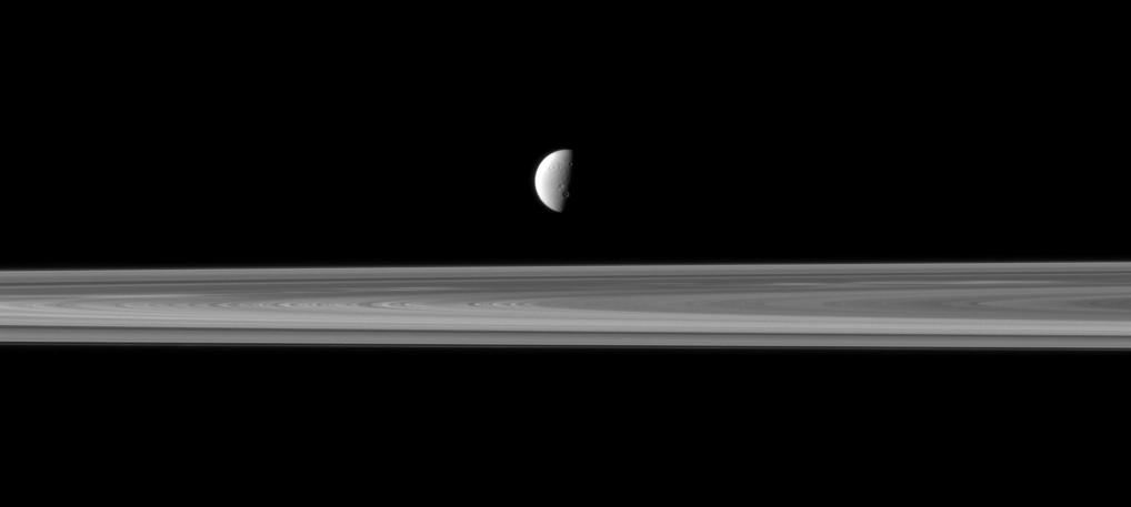Dione and Saturn's rings