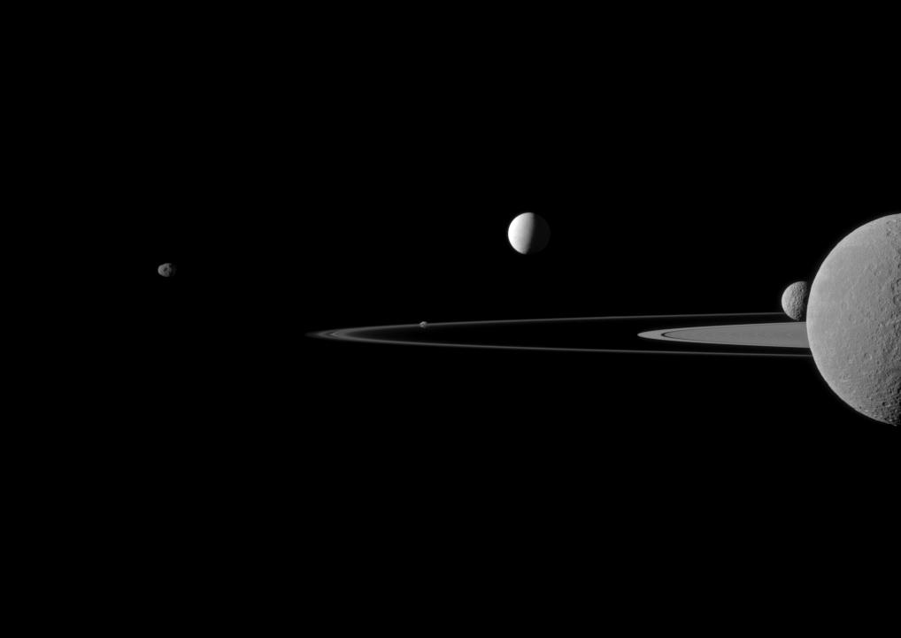 A quintet of Saturn's moons come together in the Cassini spacecraft's field of view for this portrait.