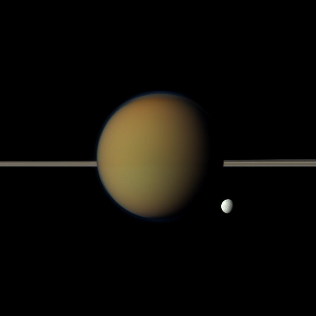 Tethys and Titan, with Saturn's rings between them