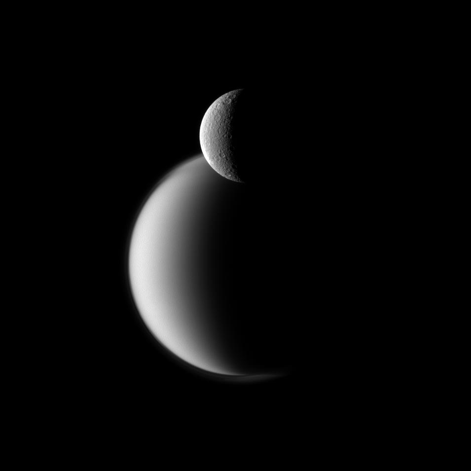 Rhea (top) and Titan