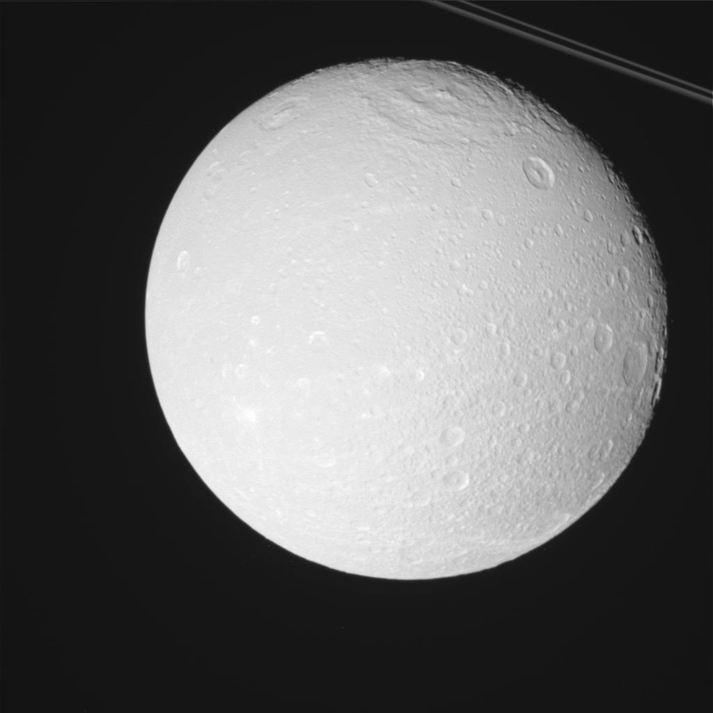 This raw, unprocessed image was taken by NASA's Cassini spacecraft on May 2, 2012. The camera was pointing toward Dione at approximately 14,835 miles (23,875 kilometers) away.