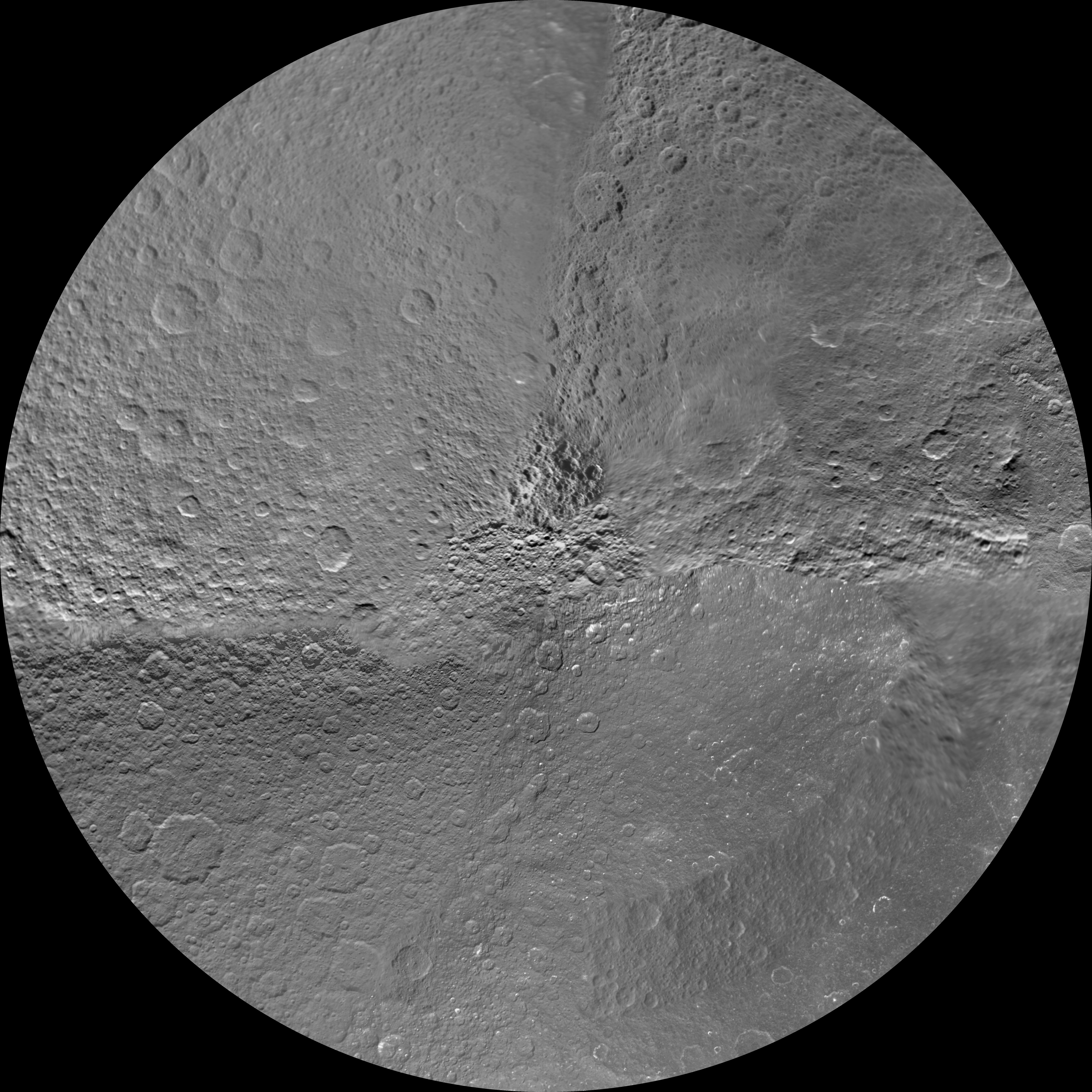 The northern and southern hemispheres of Rhea are seen in these polar stereographic maps, mosaicked from the best-available Cassini and Voyager images.
