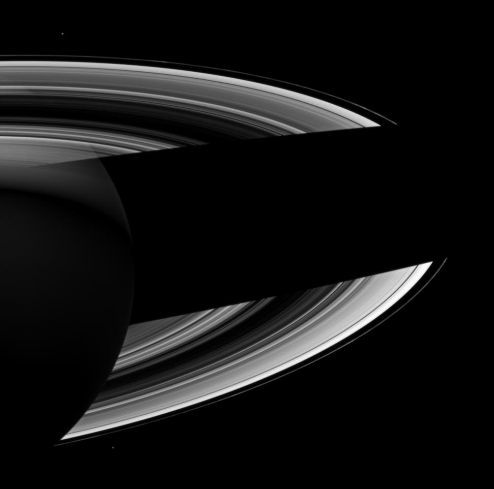 Saturn casts a wide shadow across its rings in this Cassini spacecraft view which looks toward the darkened southern hemisphere of the night side of the planet.