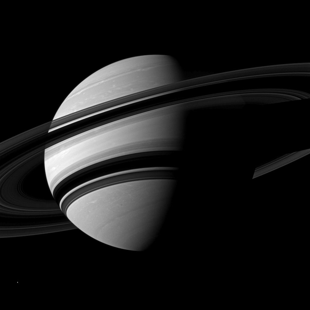 Saturn and its rings on a dramatic diagonal