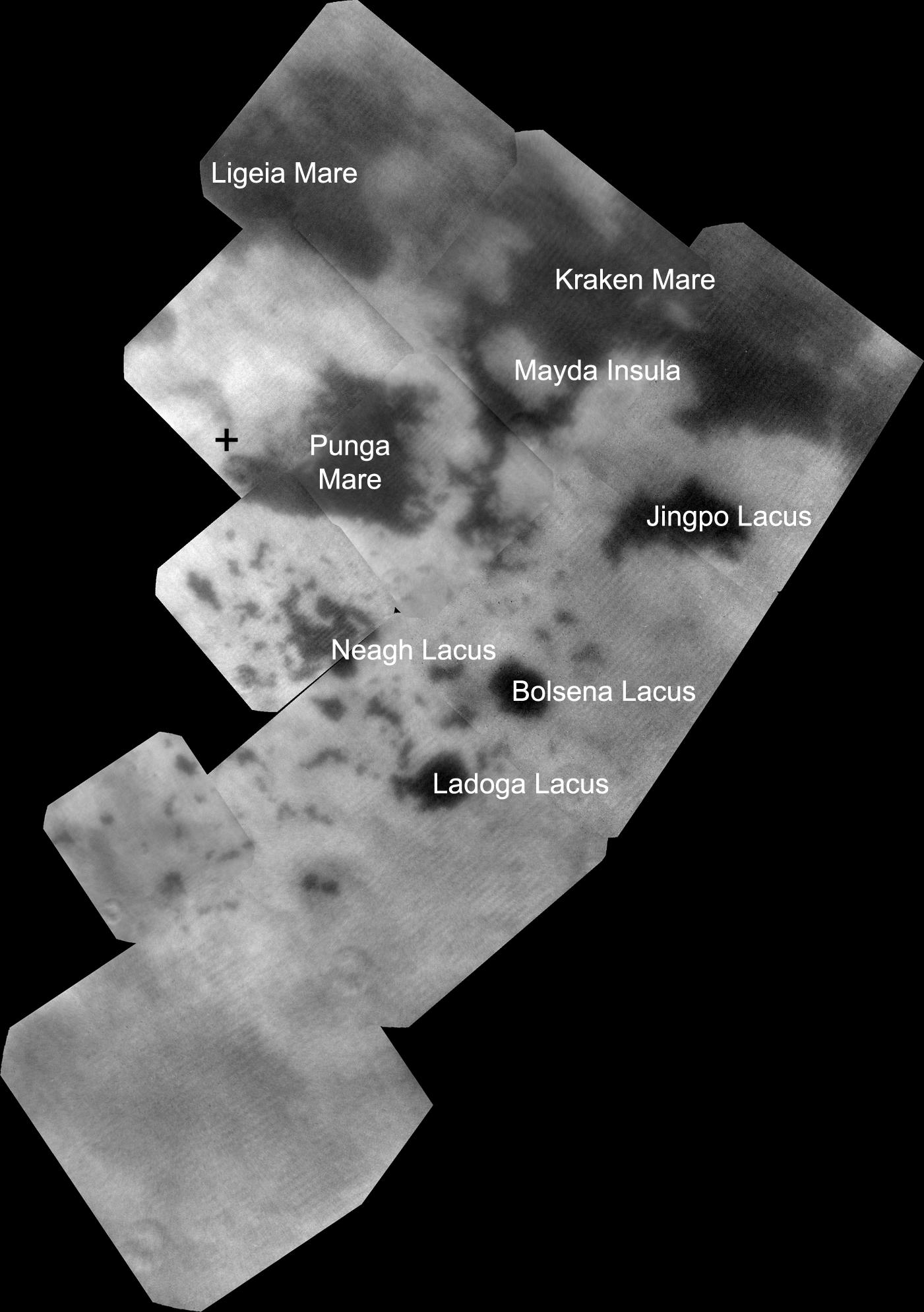 The vast hydrocarbon seas and lakes (dark shapes) near the north pole of Saturn's moon Titan sprawl out beneath the watchful eye of NASA's Cassini spacecraft.