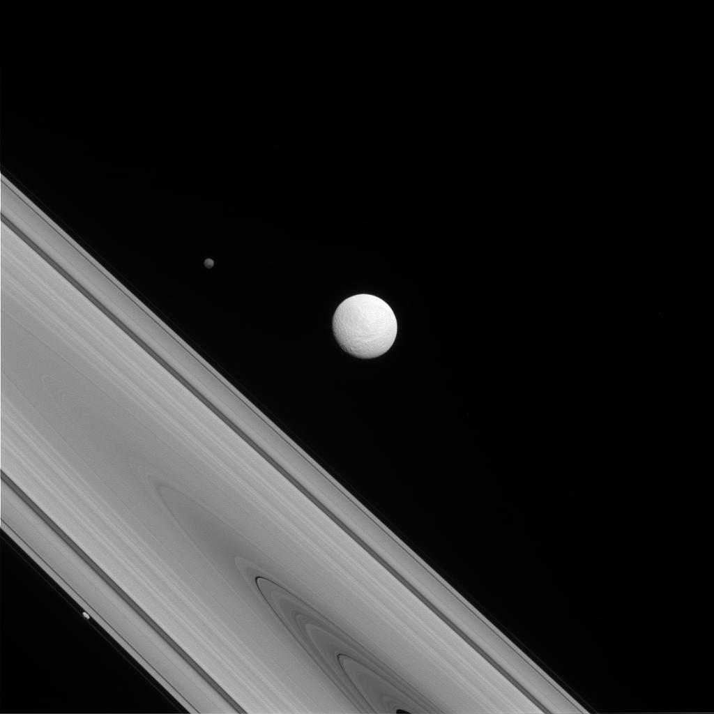 The Cassini spacecraft captures a rare family photo of three of Saturn's moons.
