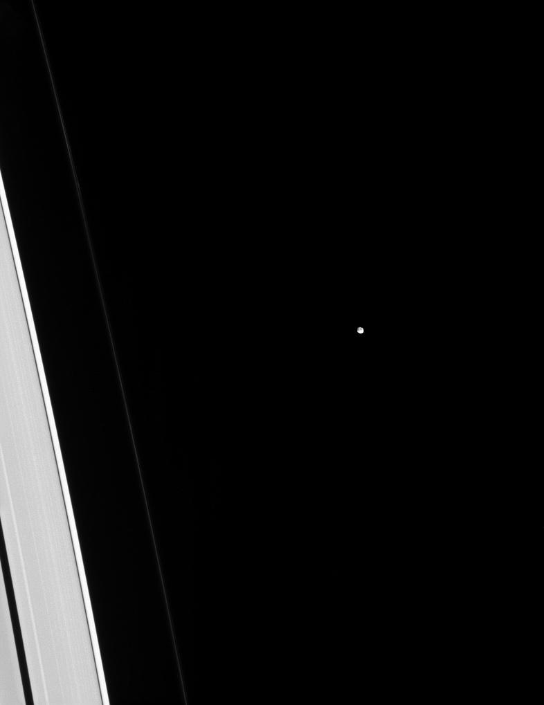 Tiny Epimetheus is dwarfed by adjacent slivers of the A and F rings