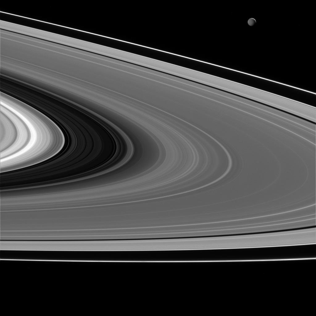 Saturn's rings and Mimas (upper right) lit by light reflected off of Saturn.
