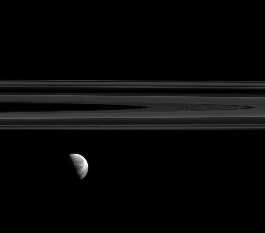 Dione's beautiful wispy terrain alongside Saturn's elegant rings