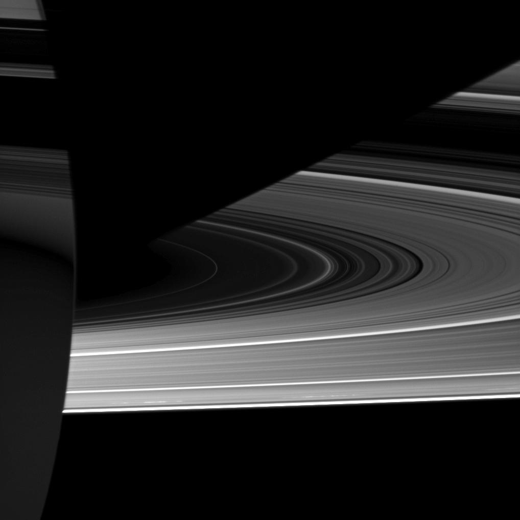 Capturing the interplay between light and shadow, the Cassini spacecraft looks toward the night side of Saturn where sunlight reflected off the rings has dimly illuminated what would otherwise be the dark side of the planet.