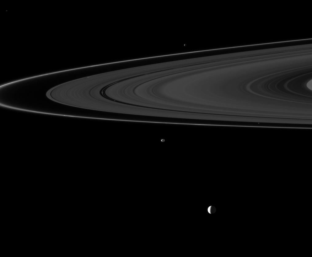 Six of Saturn's moons orbiting within and beyond the planet's rings are collected in this Cassini spacecraft image.
