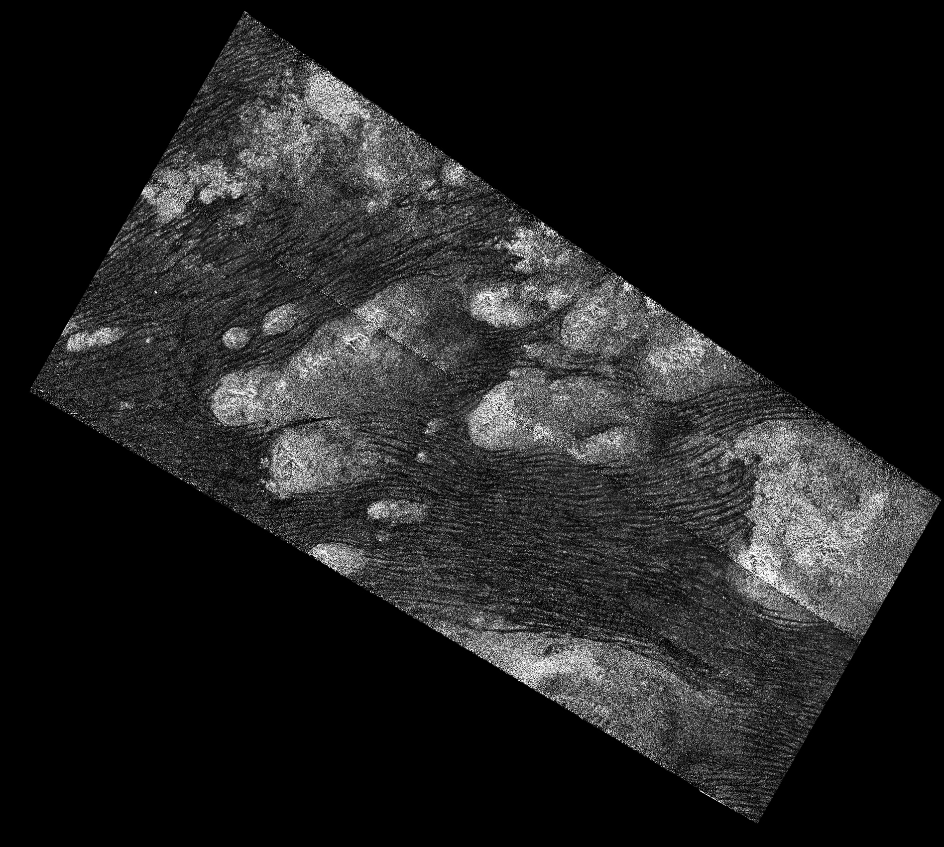 Black and white aerial view of dunes on Titan.