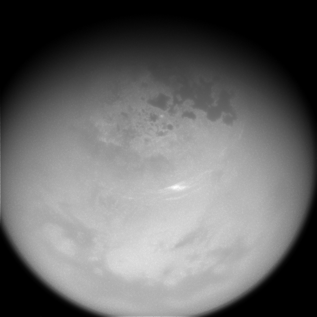 Black and white images of clouds seen on Titan from space.