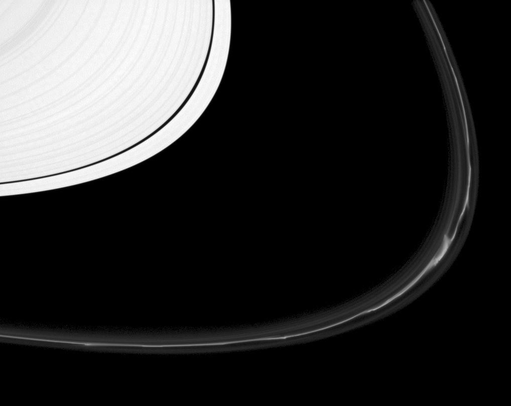 The F ring shows off a rich variety of phenomena in this image from the Cassini spacecraft.