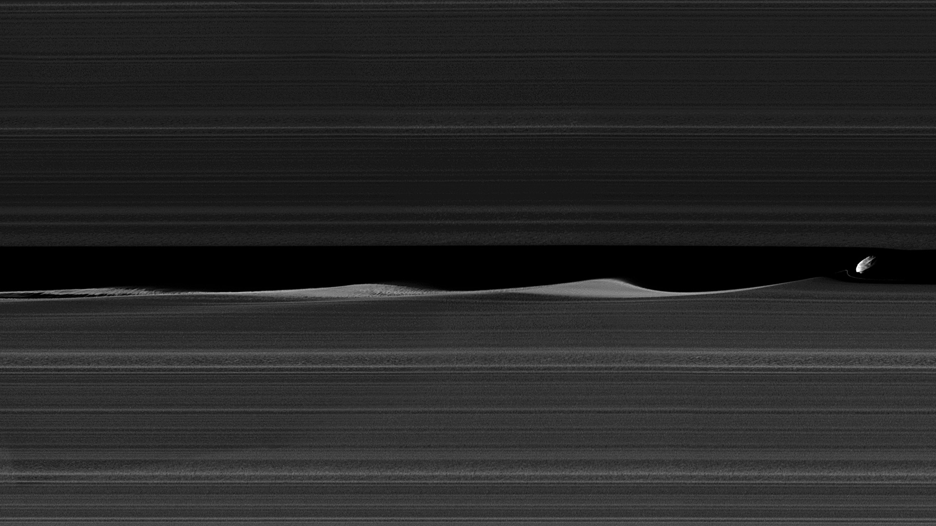 Daphnis, one of Saturn's ring-embedded moons