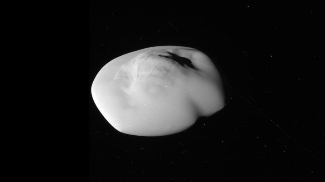 Black and white image of saucer-shaped moon.