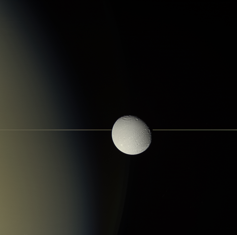 Dione and Saturn's rings seen edge on